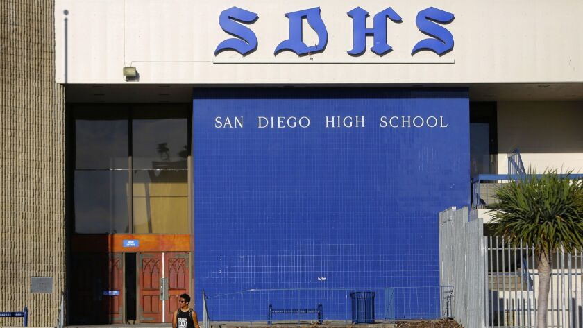 A student at San Diego High School heads home for the weekend.