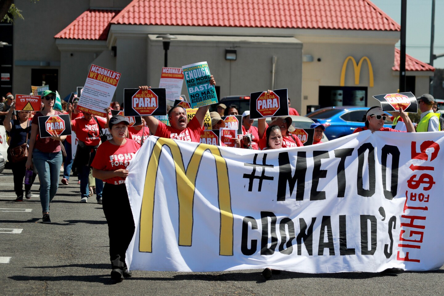 McDonald's workers, women's groups and civil rights groups stage a lunchtime strike at a South Los Angeles McDonald's to spotlight alleged sexual harassment throughout the fast-food giant's organizational culture as part of a 10-city protest.