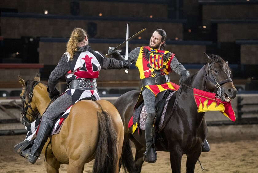 Phil La Croix, left, as Iofre Santa Creu, and Zack Synder, as Lord Del Font, rehearse a fight scene at Medieval Times in Buena Park on Wednesday, March 14. Inspire charter schools have informed parents that, as of Aug. 1, they can no longer use school enrichment funds to buy dinner theater tickets.