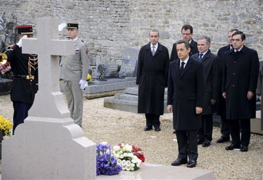 French President Nicolas Sarkozy , French Prime Minister Francois Fillon, right, and Parliament President Bernard Accoyer, 2nd right, pay respect at Charles De Gaulle's grave in Colombey les-deux-Eglises, eastern France, Tuesday Nov. 9, 2010, during the commemoration of the 40th anniversary of his death. (AP Photo/Eric Feferberg, Pool)