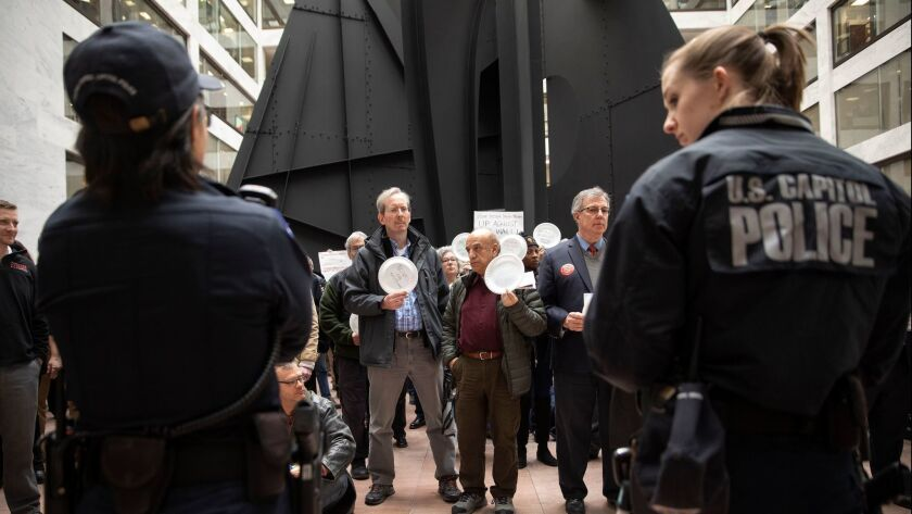 People participate in the 'Occupy Hart' protest against the partial government shutdown at the Hart Senate Office Building in Washington on Jan. 23.