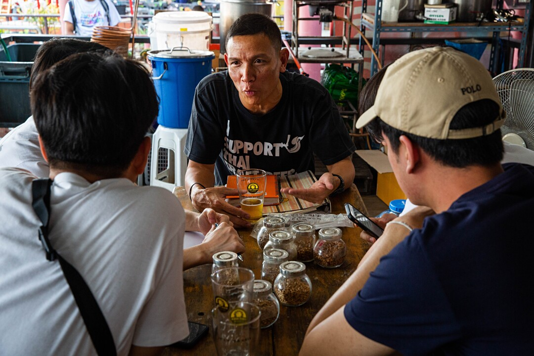 """Wichit """"Chit"""" Saiklao conducts a beer-brewing class in February 2020 in Thailand."""