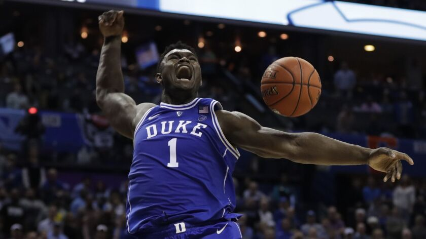FILE - In this March 15, 2019, file photo, Duke's Zion Williamson reacts after his dunk against Nort