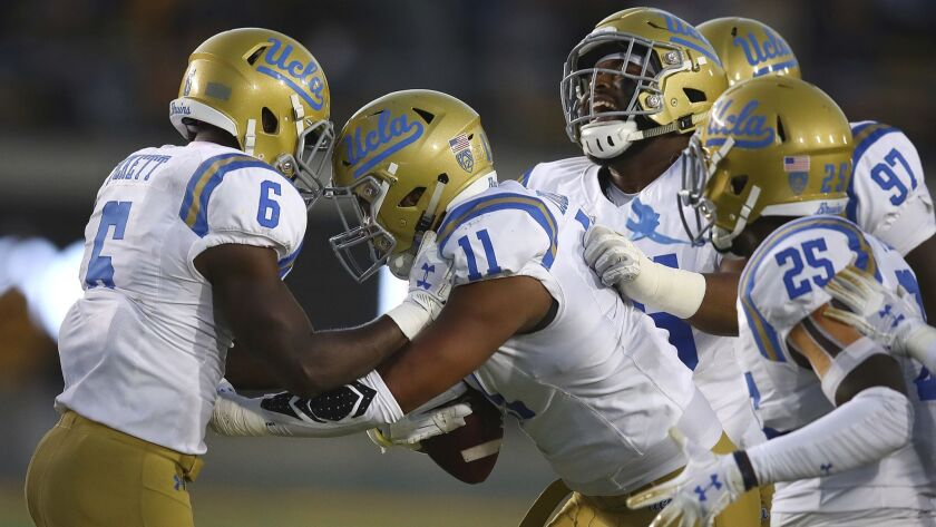 UCLA's Keisean Lucier-South (11) celebrates with Adarius Pickett (6) after intercepting a pass again