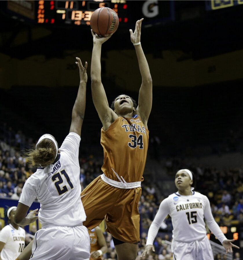 Texas center Imani McGee-Stafford (34) shoots over California forward Reshanda Gray (21) during the first half of a women's college basketball game in the second round of the NCAA tournament Sunday, March 22, 2015, in Berkeley, Calif. (AP Photo/Marcio Jose Sanchez)