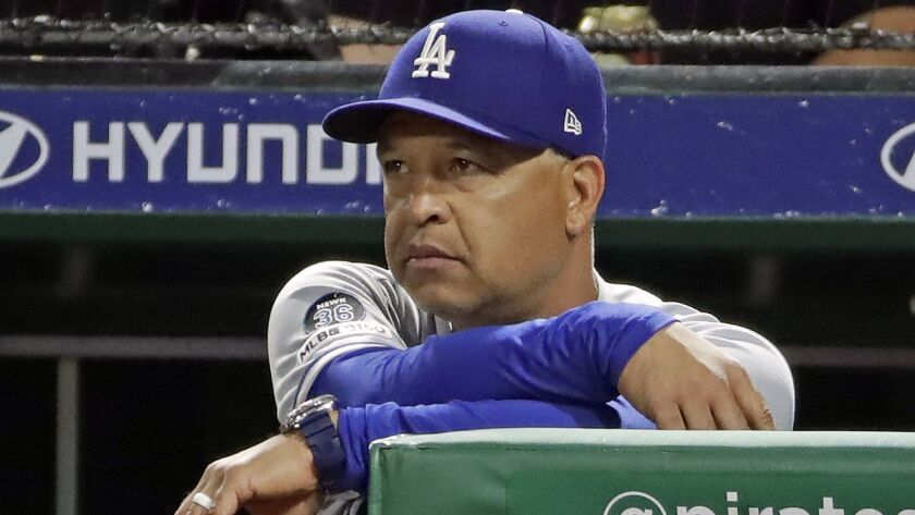 Dodgers manager Dave Roberts watches from the dugout steps during the sixth inning against the Pittsburgh Pirates in Pittsburgh on May 25.