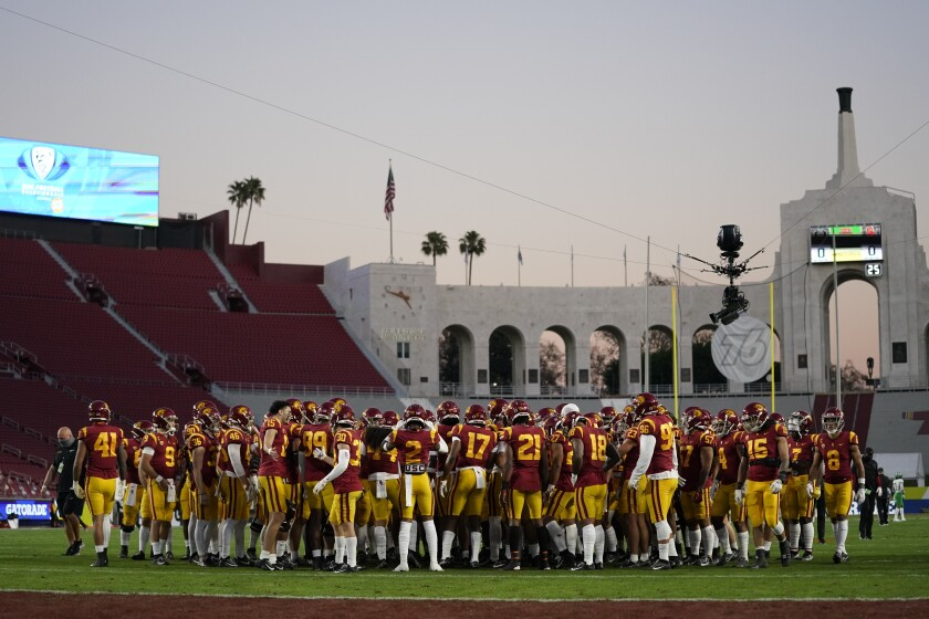 USC players gather on the field as they finish warming up before playing Oregon in the Pac-12 championship game