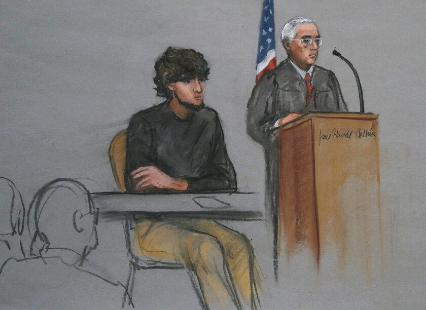 FILE - In this Jan. 5, 2015, file courtroom sketch, Boston Marathon bombing suspect Dzhokhar Tsarnaev, left, is depicted beside U.S. District Judge George O'Toole Jr., right, as O'Toole addresses a pool of potential jurors in a jury assembly room at the federal courthouse, in Boston. Lawyers for Boston Marathon bombing suspect Tsarnaev have asked a judge three times to move his trial out of Massachusetts because of the emotional impact of the deadly attack. Three times, the judge has refused. On Thursday, Feb. 19, Tsarnaev's defense team will ask a federal appeals court to take the decision out of the hands of O'Toole Jr. and order him to move the trial. They insist that Tsarnaev cannot find a fair and impartial jury in Massachusetts because too many people believe he's guilty and many have personal connections to the marathon or the bombings. (AP Photo/Jane Flavell Collins, File)