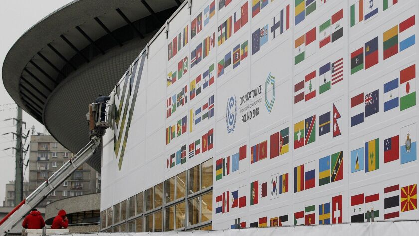 In this Nov. 20, 2018 photo workers decorate the venue of the global climate summit that will be hel