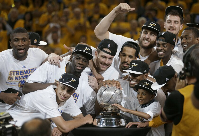 Golden State Warriors players celebrate after Game 5 of the NBA basketball Western Conference finals against the Houston Rockets in Oakland, Calif., Wednesday, May 27, 2015. The Warriors won 104-90 and advanced to the NBA Finals. (AP Photo/Ben Margot)