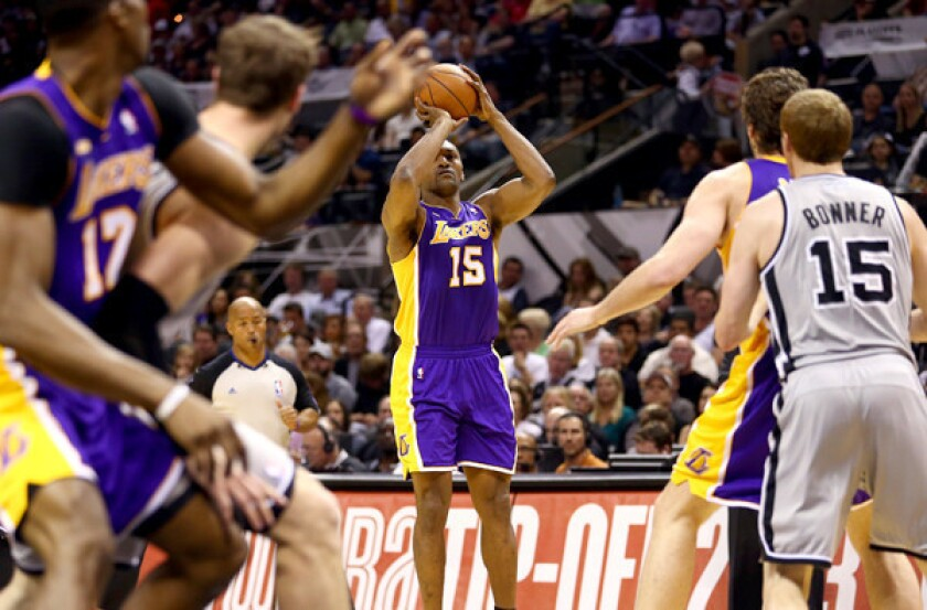 Lakers forward Metta World Peace lines up a wide-open shot as big men Dwight Howard, left, and Pau Gasol, right, are closely guarded in Game 1 of their playoff series against San Antonio.