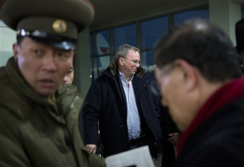 Executive Chairman of Google Eric Schmidt, center, arrives at Pyongyang International Airport in Pyongyang, North Korea on Monday, Jan. 7, 2013. Schmidt arrived in the North Korean capital along with former New Mexico Gov. Bill Richardson. Richardson called the trip to North Korea a private humanitarian visit. (AP Photo/David Guttenfelder)
