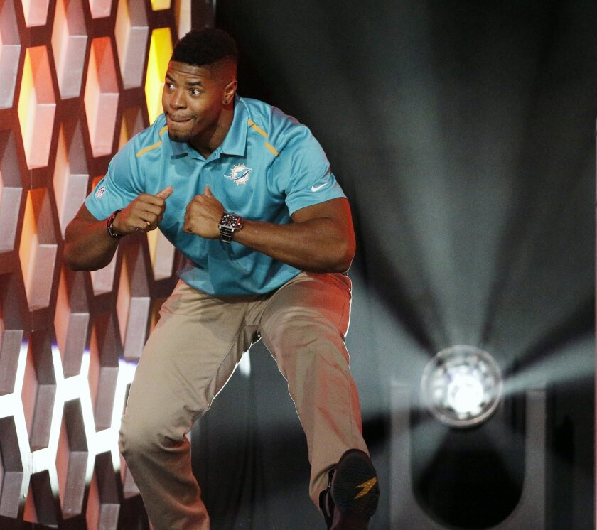 Miami Dolphins' Cameron Wake reacts after being introduced during the NFL football Pro Bowl draft Wednesday, Jan. 21, 2015, in Phoenix. (AP Photo/David J. Phillip)