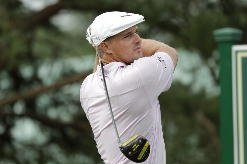 Bryson DeChambeau hits from the 11th tee during the first round of the Memorial golf tournament, Thursday, July 16, 2020, in Dublin, Ohio. (AP Photo/Darron Cummings)