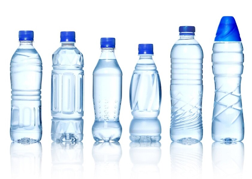 A lineup of plastic water bottles.