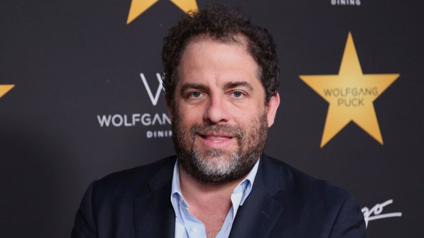 Beverly Hills police investigated filmmaker Brett Ratner, shown, and music mogul Russell Simmons for alleged sexual battery in 2001, but no charges were filed.