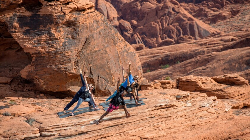 Feel the stretch on red rock slabs in Valley of Fire State Park, a helicopter hop from the Vegas Str
