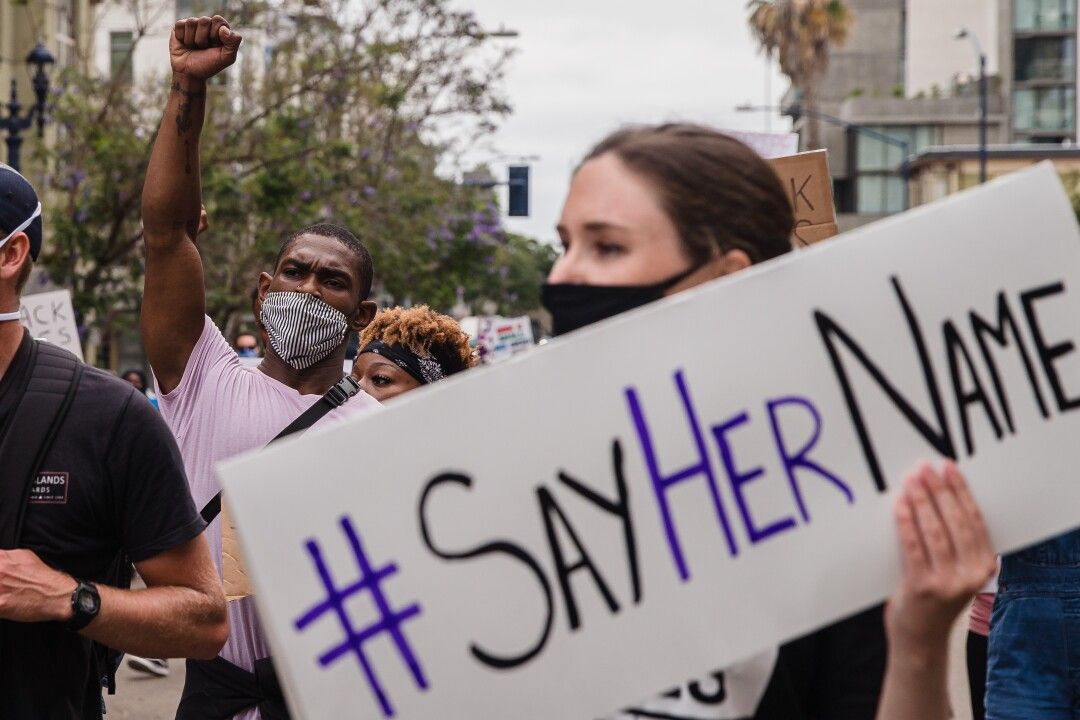 """Protesters march through downtown for a """"Girls March"""" on June 20, 2020 in San Diego, California."""
