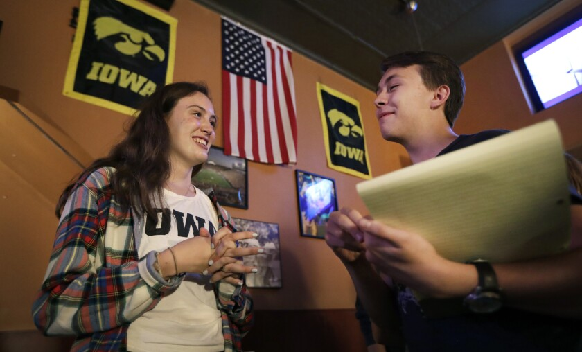University of Iowa students Abigail Simon and Mitchell Dunn talk during a Hillary Clinton campaign organizing event in Iowa City.