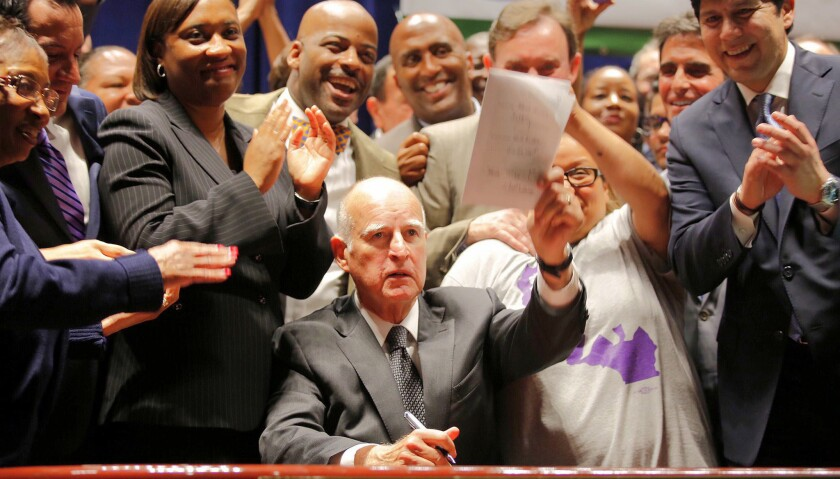 Jerry Brown signs minimum wage