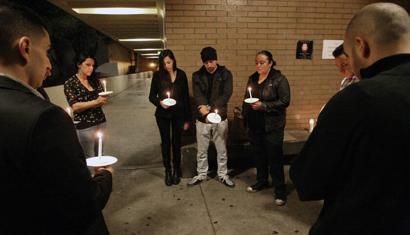 Friends and family gather for a candle vigil at Glendale High on Monday, October 5, 2105 in memory of Minas Arutyunyan after he died following a stabbing recently.