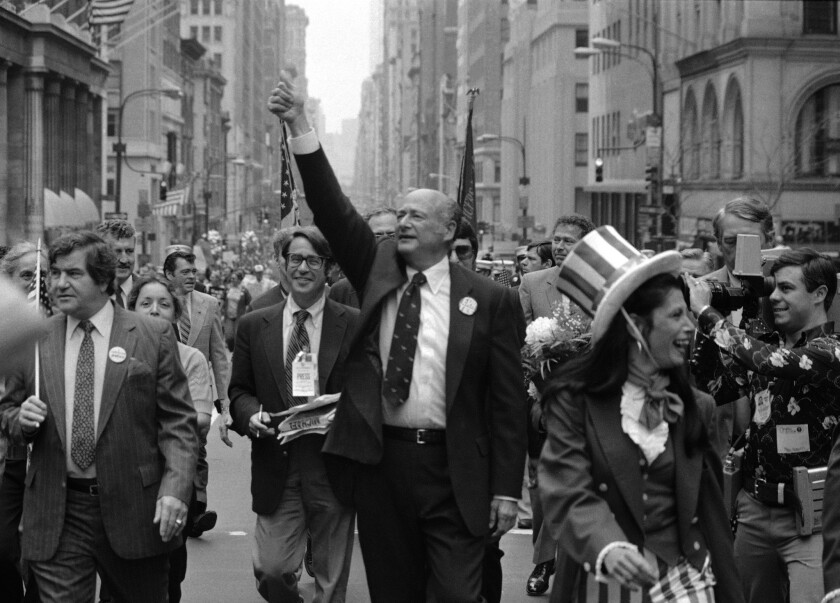 In this Sept. 7, 1981 file photo, New York City Mayor Ed Koch, center, gestures as he marches in a Labor Day parade down New York's Fifth Avenue.