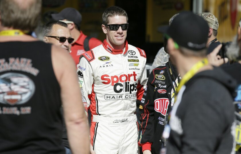 Carl Edwards walks to the garage before the start of NASCAR Sprint Cup auto racing practice at Texas Motor Speedway Friday, Nov. 6, 2015, in Fort Worth, Texas. (AP Photo/LM Otero)