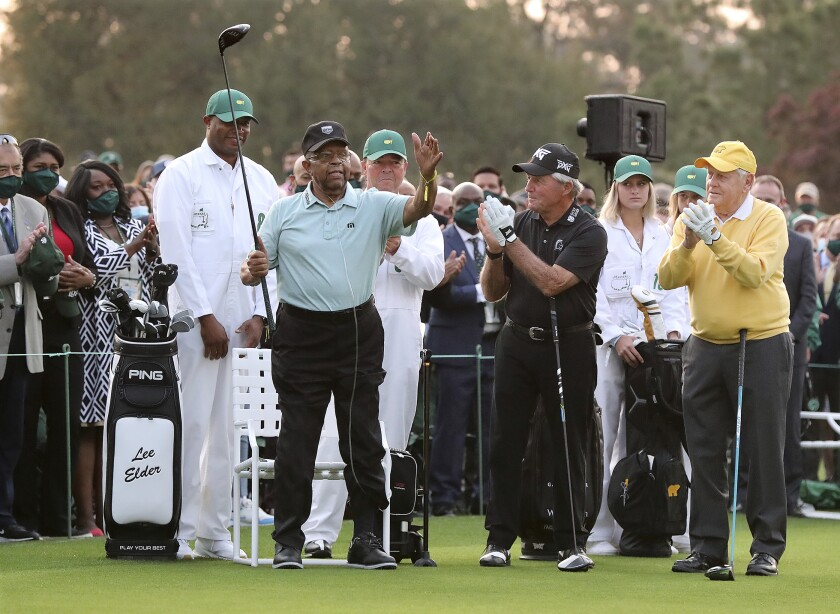 Honorary starter Lee Elder (left) is introduced and applauded by honorary starters Gary Player and Jack Nicklaus (right).