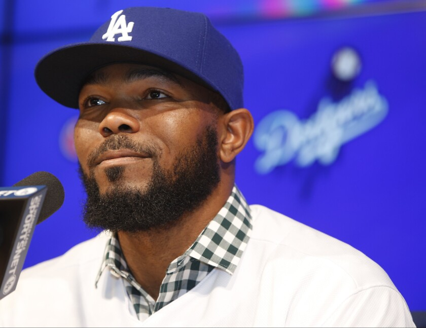 Dodgers second baseman Howie Kendrick takes questions during an introductory news conference on Dec. 19.