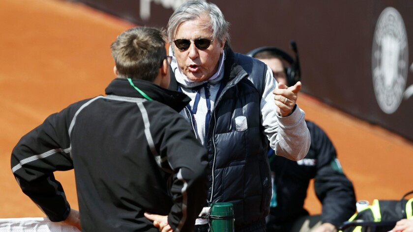 Romania team captain Ilie Nastase argues with an ITF official during the Fed Cup match against Britain on Saturday.