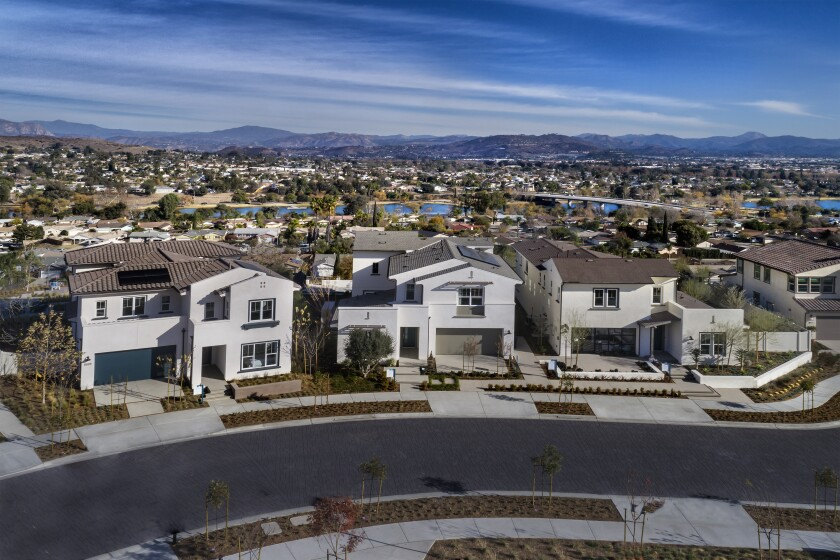 This aerial photo shows a street view of Lake Ridge, a neighborhood in Pardee Homes' Weston community, set against the sweeping background of Santee.