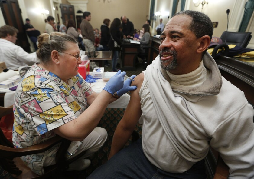 Flu outbreak remains high, but waning, CDC says