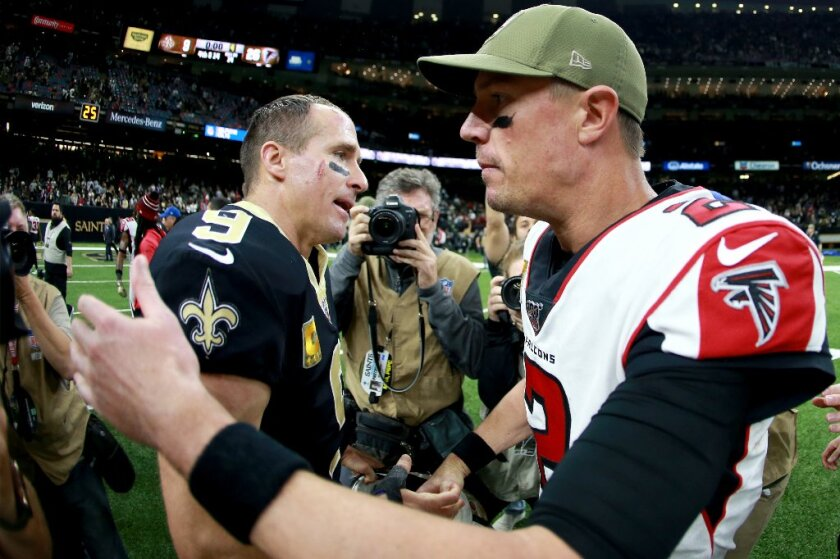 Saints quarterback Drew Brees (left) and Falcons counterpart Matt Ryan share a moment on Sunday after Atlanta upset New Orleans as a two-touchdown underdog.