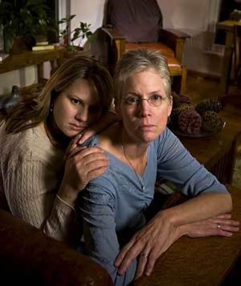 Carrie Thomas comforts her mother, Vickie Burton, whose husband, Steven, died after checking into a Sacramento hospital for treatment of alcohol abuse and depression.