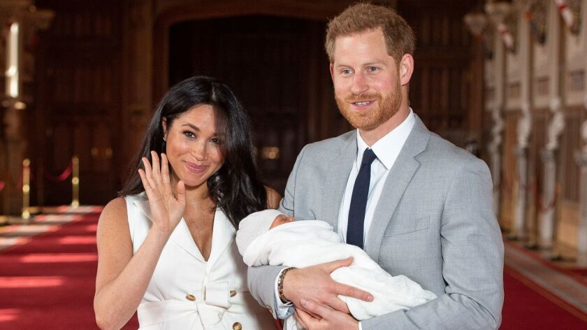Prince Harry and his wife, Meghan, introduce Master Archie Harrison Mountbatten-Windsor. He's not a prince, but he'll be entitled to become one later; it's complicated.