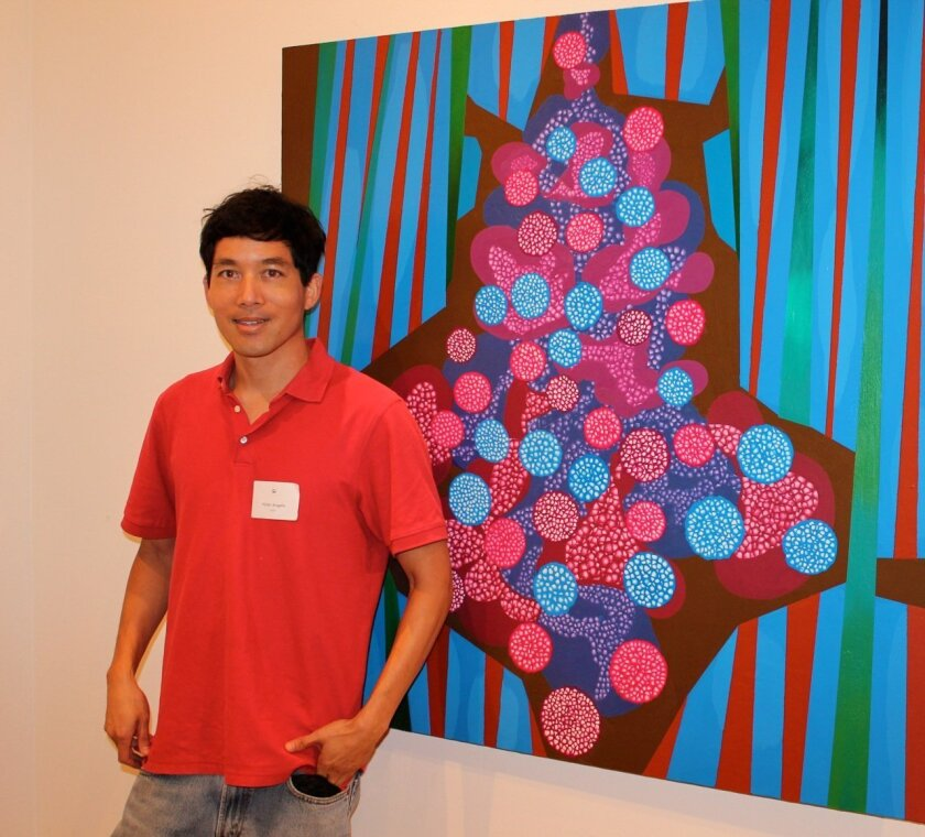 """Victor Angelo poses with his work, """"Birth."""""""