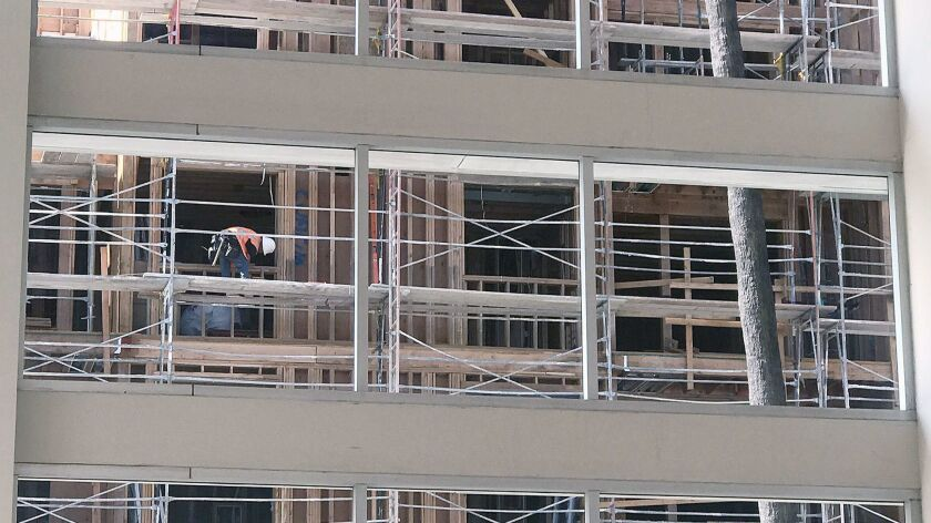 A single construction worker appears in the windows of the Kaiser Permanente Glendale Orange Street