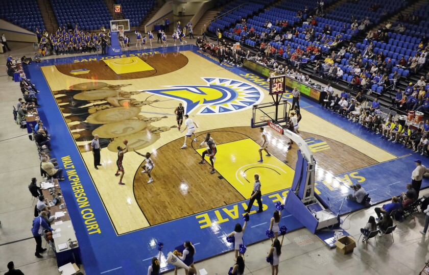 A view of San Jose State's colorful floor at The Event Center, with Spartan warriors holding shields spelling out S-J-S-U.