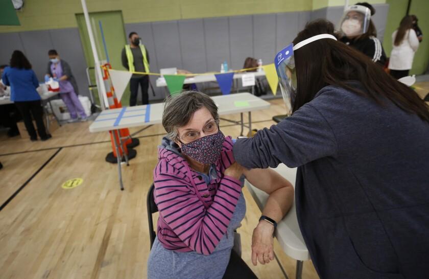 A Los Angeles substitute teacher receives a coronavirus vaccine.