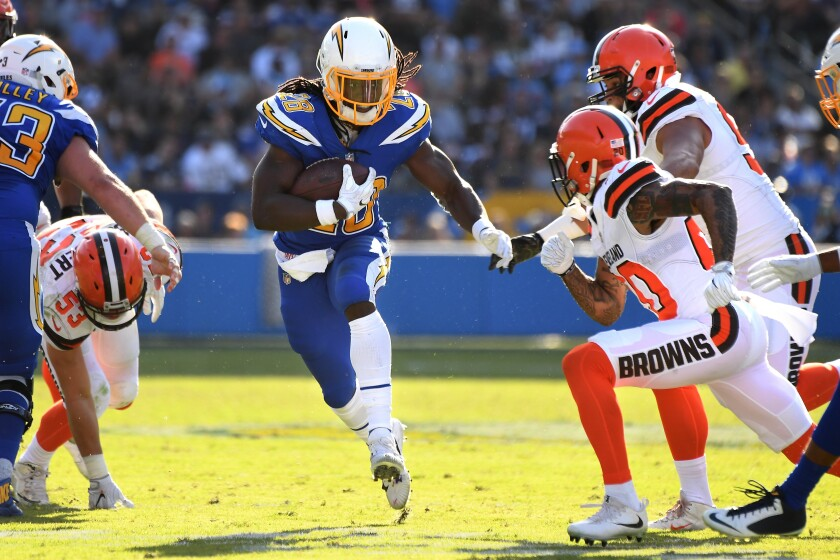 The Chargers' Melvin Gordon finds running room in the middle of the line.
