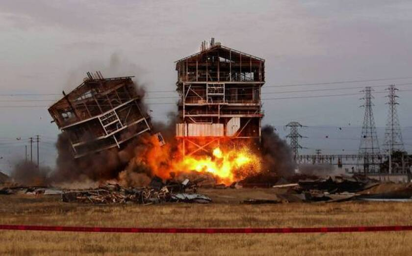 An planned implosion takes down two towers at an old steam plant in Bakersfield. Two spectators were seriously hurt by flying debris. One lost a leg.