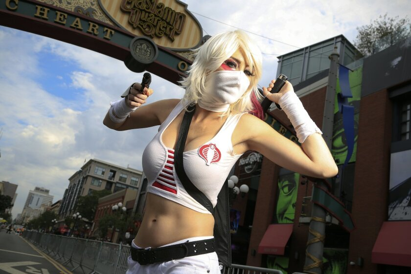 Walking down the Gaslamp Quarter in San Diego is Chandra Woodworth dressed as a storm shadow for Comic-Con 2014 in San Diego.