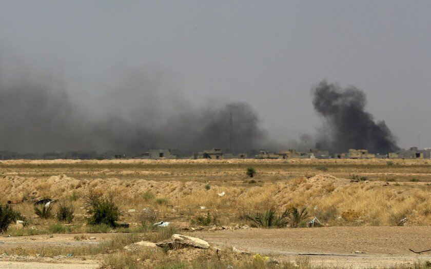 Smoke rises after an airstrike by U.S.-led coalition warplanes as Iraqi security forces advance towards Shuhada neighborhood of Fallujah, Iraq, Friday, June 3, 2016, during fighting between Iraqi security forces and the Islamic State group during a military operation to regain control the city.  Th