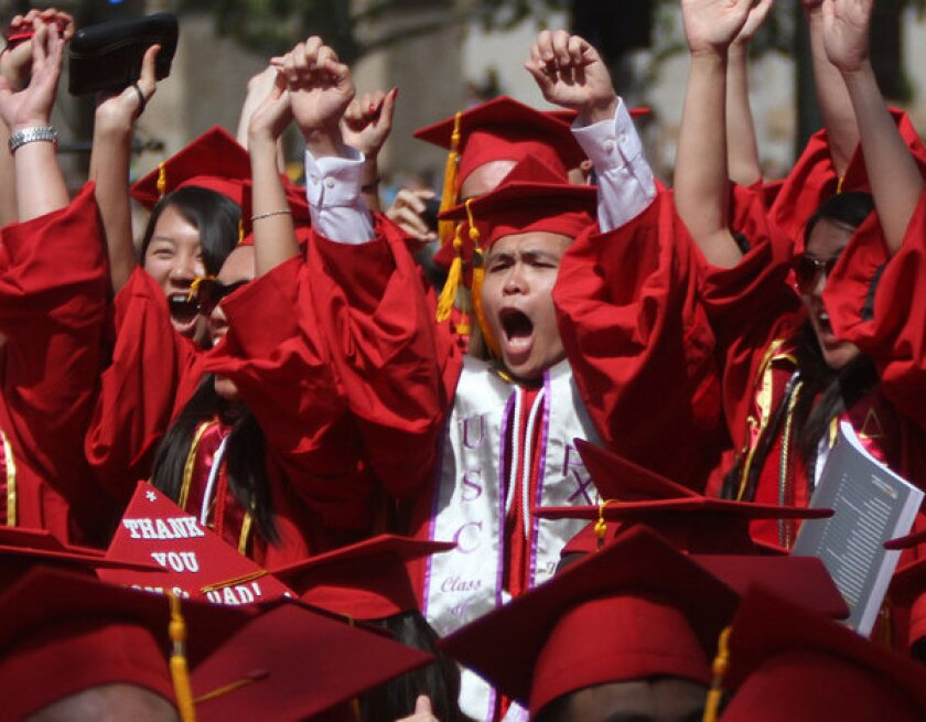 College graduates, like these from USC, earn much more than young people without degrees, according to a new study.