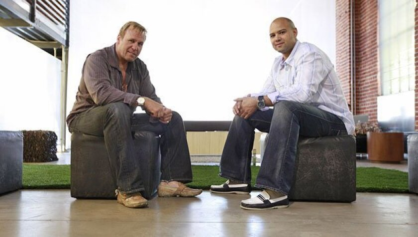 Graham Downes (left), with business partner Jason Harper, envisioned a  shared workplace for young professionals who would feed off one another's  creative energy. (John R. McCutchen / U-T)