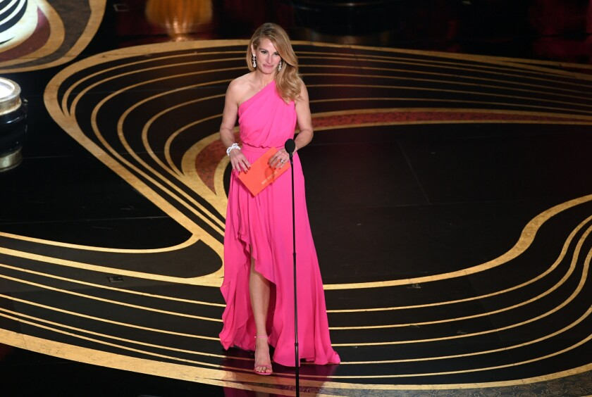 Julia Roberts, who presented best picture at the Oscars Sunday night, was one of the many actresses who came to the event dressed in various shades of pink.