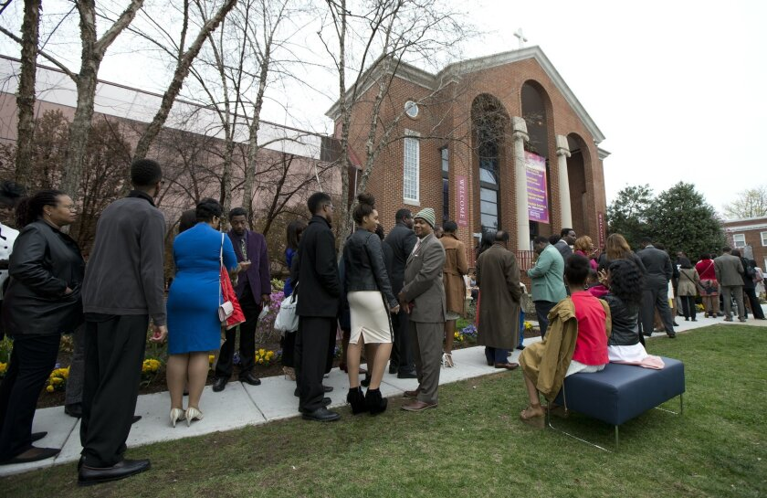 Churchgoers line up outside the historic Alfred Street Baptist Church in Alexandria, Va., Sunday, March 27, 2016, where President Barack Obama and his family joined the congregation to celebrate Easter. (AP Photo/Manuel Balce Ceneta)