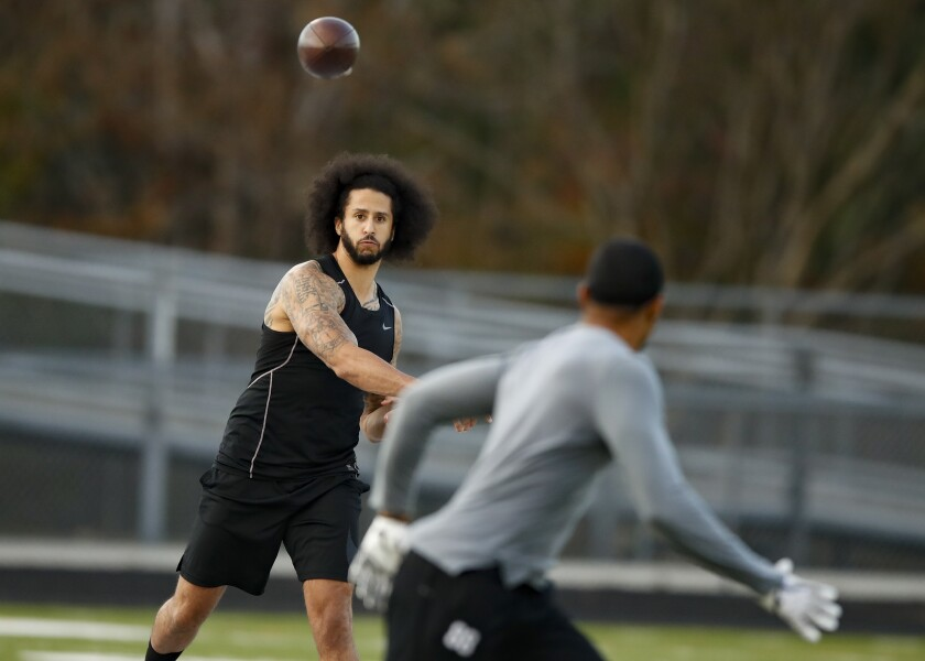 Colin Kaepernick participates in a workout for NFL football scouts in November.