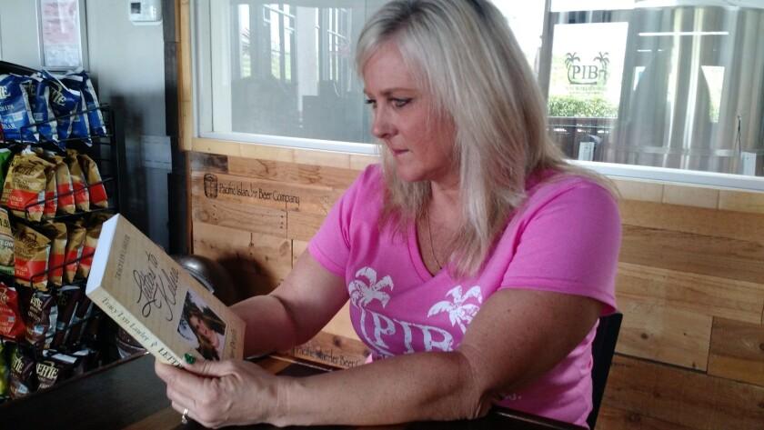 """Tracy Lawler reads an excerpt from her book, """"Letters to Kelsea: Life After Death,"""" at Pacific Islander Brewery in Santee. Lawler lost her 17-year-old daughter, Kelsea, in 2006."""