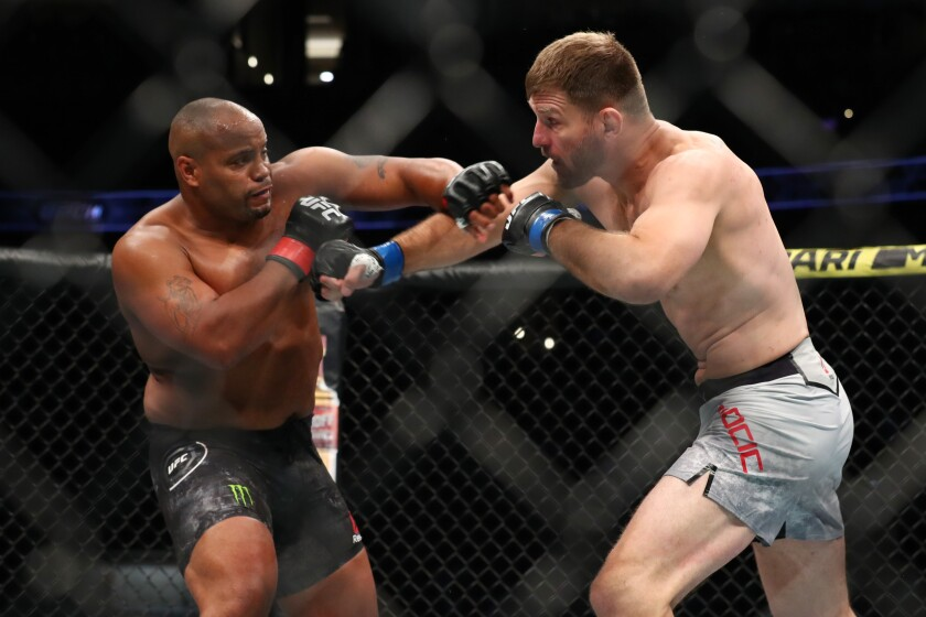 Daniel Cormier and Stipe Miocic throw blows in the first round of their UFC heavyweight title fight at UFC 241 at Honda Center on Saturday.
